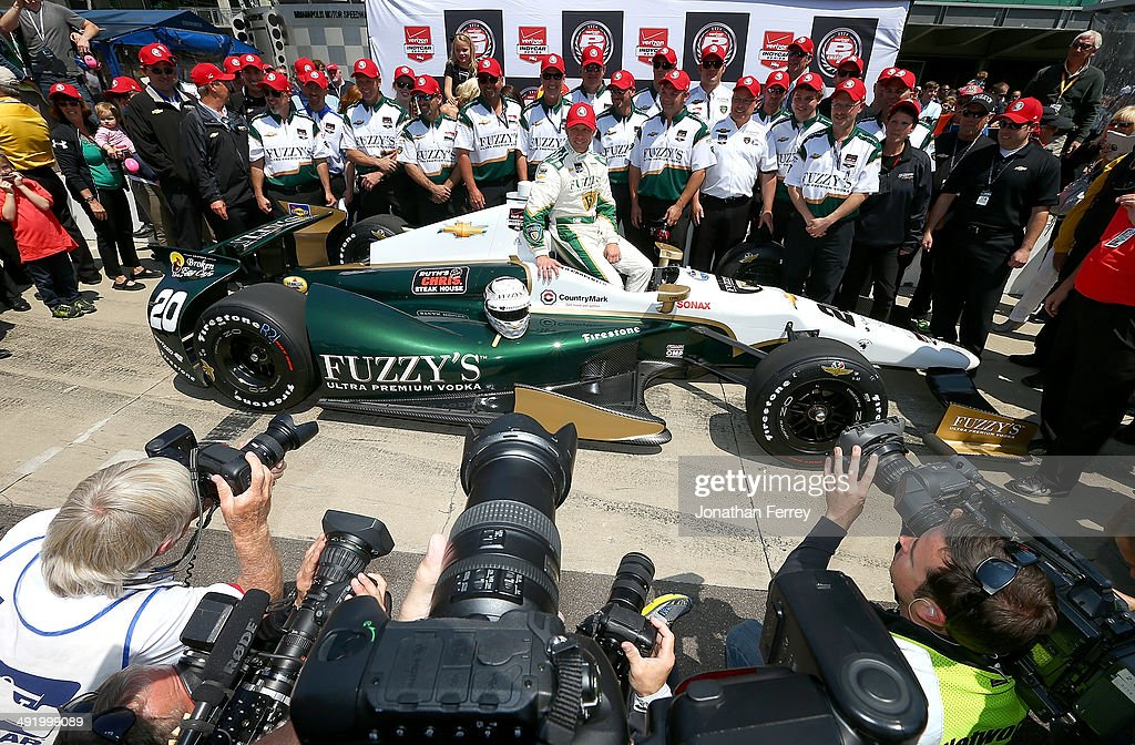 <a gi-track='captionPersonalityLinkClicked' href=/galleries/search?phrase=Ed+Carpenter&family=editorial&specificpeople=224777 ng-click='$event.stopPropagation()'>Ed Carpenter</a>, driver of the #20 Fuzzy's Vodka <a gi-track='captionPersonalityLinkClicked' href=/galleries/search?phrase=Ed+Carpenter&family=editorial&specificpeople=224777 ng-click='$event.stopPropagation()'>Ed Carpenter</a> Racing Chevrolet Dallara poses for a photo after winning the pole position for the 98th Indianapolis 500 Mile Race on May 18, 2014 at the Indianapolis Motor Speedway in Indianapolis, Indiana.
