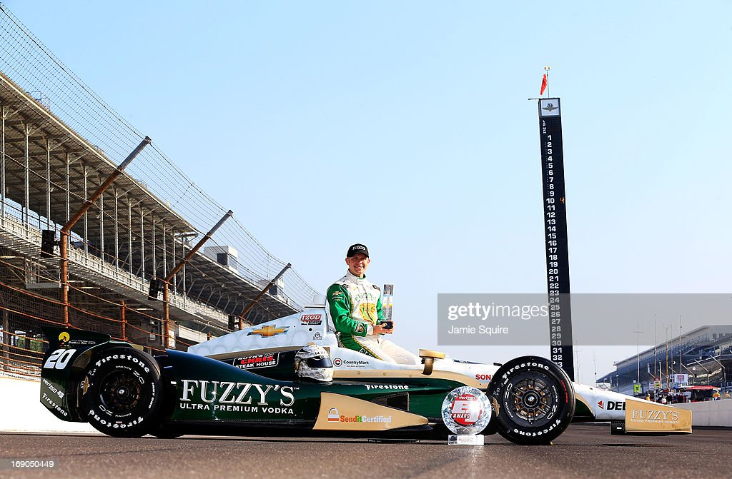 <a gi-track='captionPersonalityLinkClicked' href=/galleries/search?phrase=Ed+Carpenter&family=editorial&specificpeople=224777 ng-click='$event.stopPropagation()'>Ed Carpenter</a>, driver of the #20 Fuzzy's Vodka/<a gi-track='captionPersonalityLinkClicked' href=/galleries/search?phrase=Ed+Carpenter&family=editorial&specificpeople=224777 ng-click='$event.stopPropagation()'>Ed Carpenter</a> Racing Chevrolet, poses on the track after qulaifying on the pole for the 2013 Indianapolis 500 at Indianapolis Motor Speedway on May 19, 2013 in Indianapolis, Indiana.