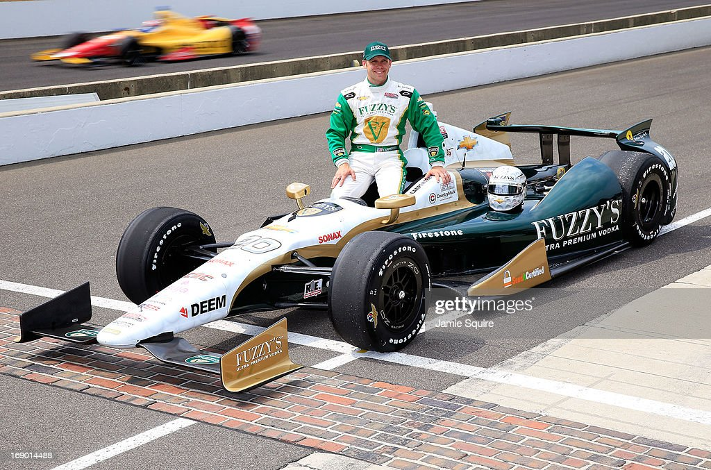 Ed Carpernter, driver of the #20 Fuzzy's Vodka/Ed Carpenter Racing Chevrolet, poses after qualifying for the 2013 Indianapolis 500 at Indianapolis Motor Speedway as Carlos Munoz, driver of the Andretti Autosport Unistraw Chevrolet qualifies behind him on May 18, 2013 in Indianapolis, Indiana.