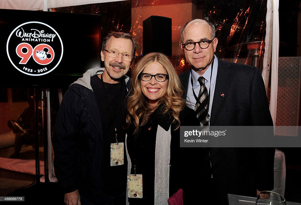 Ed Catmull, President, Walt Disney and Pixar Animation Studios, director Jennifer Lee and David Sameth, SVP of Marketing, Walt Disney Company pose at a reception to celebrate 90 Years of Disney animation at The Walt Disney Studios on December 10, 2013 in Burbank, California.