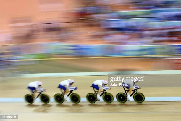 Ed Clancy Paul Manning Geraint Thomas and Bradley Wiggins of Great Britain compete during qualifying for the men's team pursuit track cycling event...