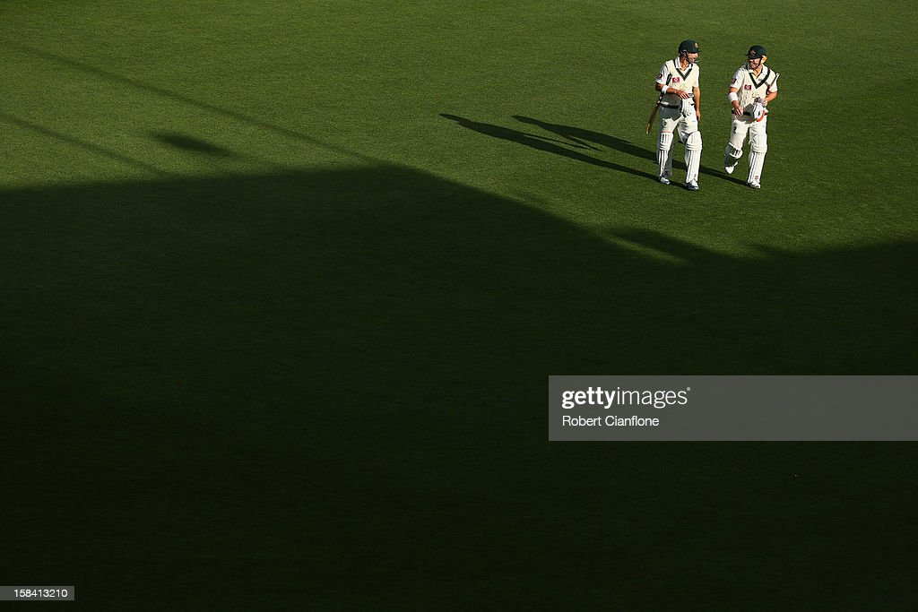 Ed Cowan and David Warner of Australia walk off the ground after play on day three of the First Test match between Australia and Sri Lanka at Blundstone Arena on December 16, 2012 in Hobart, Australia.