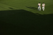 Ed Cowan and David Warner of Australia walk off the ground after play on day three of the First Test match between Australia and Sri Lanka at...