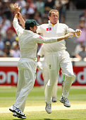 Ed Cowan celebrates with Peter Siddle of Australia after he had Gambhir caught by Ricky Ponting during day four of the First Test match between...