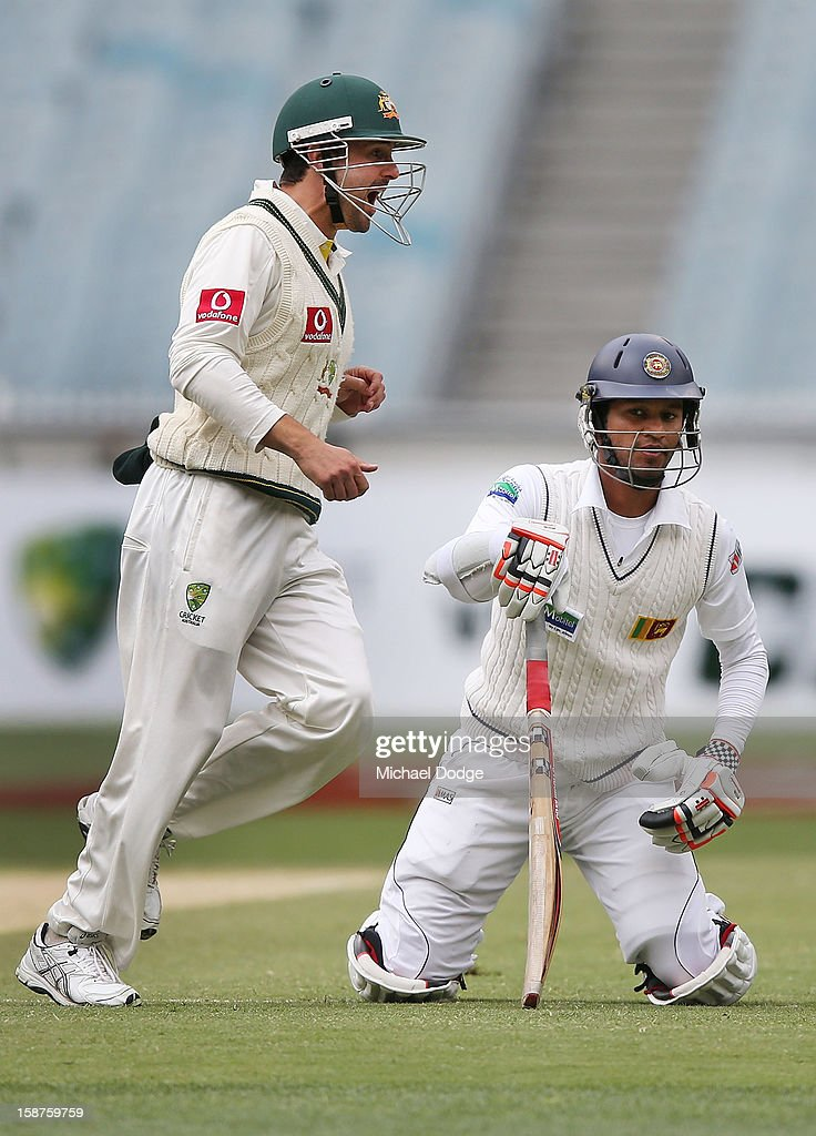 Ed Cowan of Australia celebrates the run out of Dimuth Karunaratne of Sri Lanka during day three of the Second Test match between Australia and Sri Lanka at Melbourne Cricket Ground on December 28, 2012 in Melbourne, Australia.