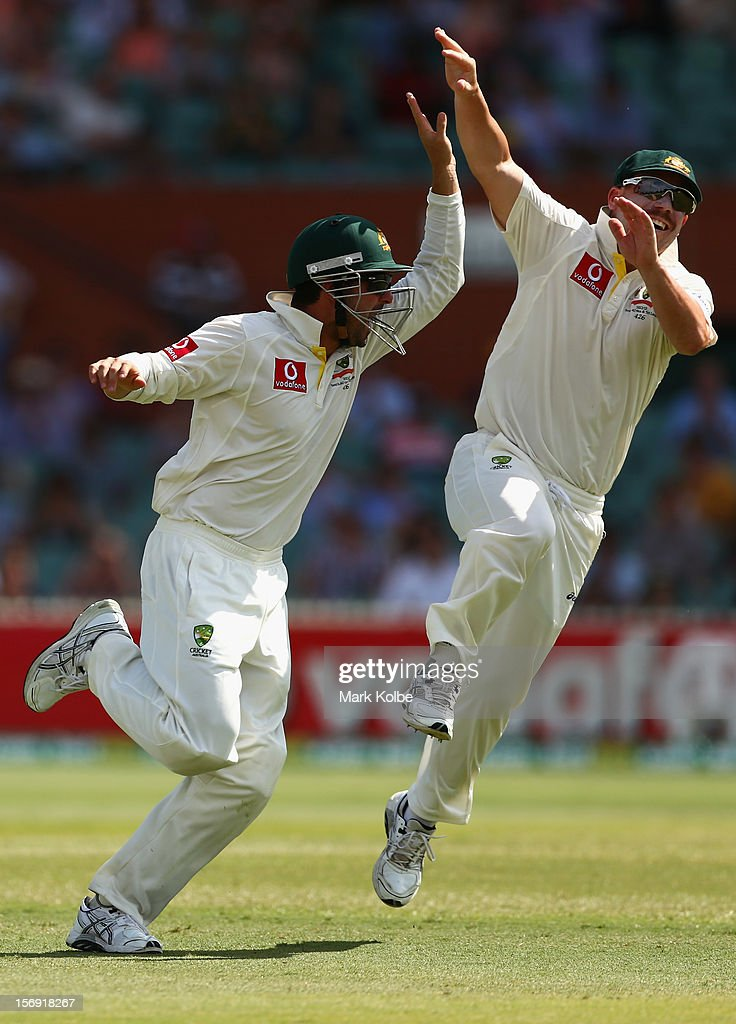 Ed Cowan of Australia celebrates with David Warner of Australia after catching Jacques Rudolph of South Africa during day four of the Second Test Match between Australia and South Africa at Adelaide Oval on November 25, 2012 in Adelaide, Australia.