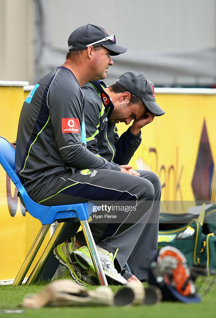 <a gi-track='captionPersonalityLinkClicked' href=/galleries/search?phrase=Ed+Cowan&family=editorial&specificpeople=2207390 ng-click='$event.stopPropagation()'>Ed Cowan</a> of Australia speaks with <a gi-track='captionPersonalityLinkClicked' href=/galleries/search?phrase=Mickey+Arthur&family=editorial&specificpeople=789398 ng-click='$event.stopPropagation()'>Mickey Arthur</a>, coach of Australia during day four of the First Test match between Australia and Sri Lanka at Blundstone Arena on December 17, 2012 in Hobart, Australia.