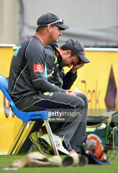 Ed Cowan of Australia speaks with Mickey Arthur coach of Australia during day four of the First Test match between Australia and Sri Lanka at...