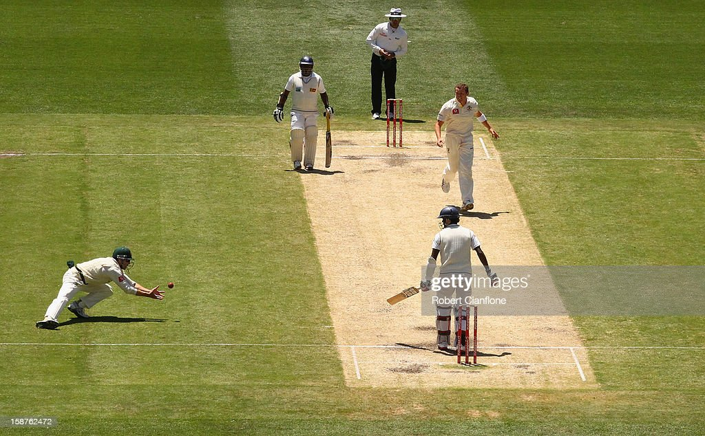 Ed Cowan of Australia takes a catch to dismiss Shaminda Eranga of Sri Lanka to give Australia victory during day three of the Second Test match between Australia and Sri Lanka at Melbourne Cricket Ground on December 28, 2012 in Melbourne, Australia.
