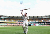 Ed Cowan of Australia thanks the crowd after being run out for 136 during day four of the First Test match between Australia and South Africa at The...