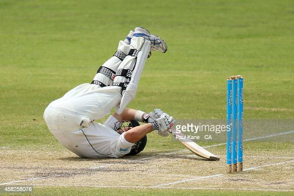 Ed Cowan of Tasmania avoids a high delivery from Nathan CoulterNile of Western Australia during day three of the Sheffield Shield match between...
