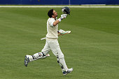 Ed Cowan of Tasmania celebrates after scoring a century during day one of the Sheffield Shield match between Tasmania and South Australia at...