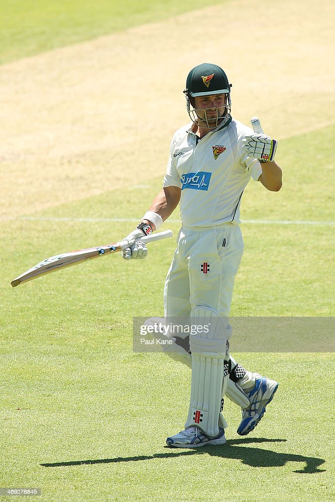 <a gi-track='captionPersonalityLinkClicked' href=/galleries/search?phrase=Ed+Cowan&family=editorial&specificpeople=2207390 ng-click='$event.stopPropagation()'>Ed Cowan</a> of the Tigers acknowledges the rooms after reaching his half century during day three of the Sheffield Shield match between the Western Australia Warriors and the Tasmania Tigers at the WACA on February 14, 2014 in Perth, Australia.