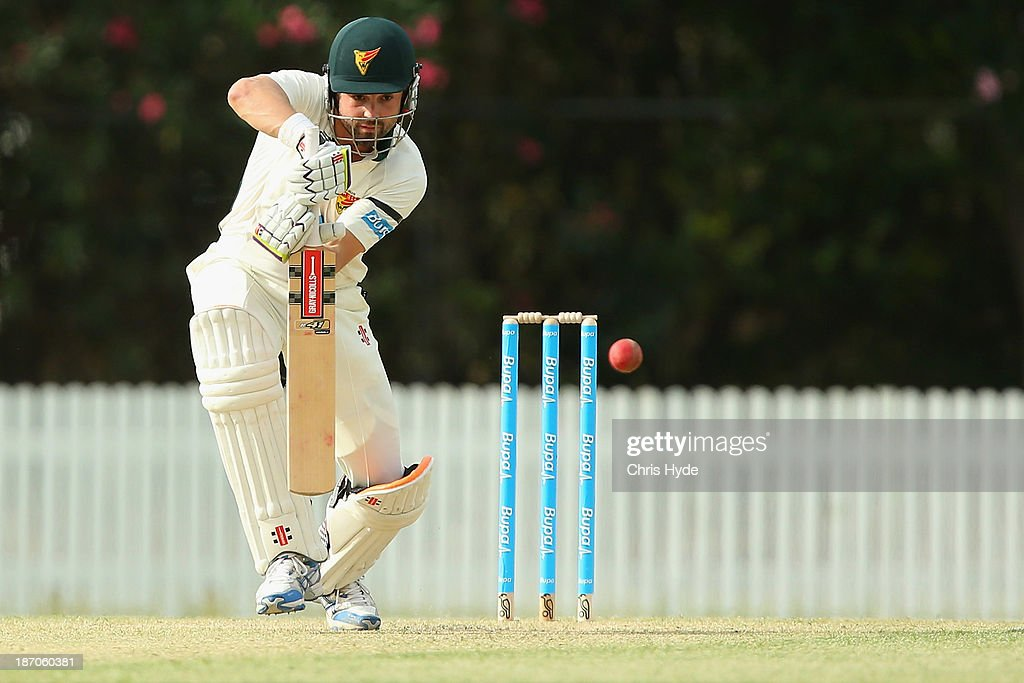 <a gi-track='captionPersonalityLinkClicked' href=/galleries/search?phrase=Ed+Cowan&family=editorial&specificpeople=2207390 ng-click='$event.stopPropagation()'>Ed Cowan</a> of the Tigers bats during day one of the Sheffield Shield match between the Queensland Bulls and the Tasmania Tigers at Allan Border Field on November 6, 2013 in Brisbane, Australia.
