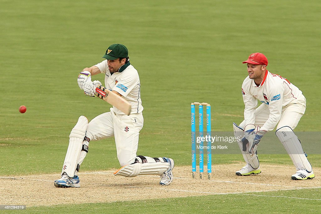 <a gi-track='captionPersonalityLinkClicked' href=/galleries/search?phrase=Ed+Cowan&family=editorial&specificpeople=2207390 ng-click='$event.stopPropagation()'>Ed Cowan</a> of the Tigers bats in front of Tim Ludeman of the Redbacks during day one of the Sheffield Shield match between the South Australia Redbacks and the Tasmania Tigers at Adelaide Oval on November 22, 2013 in Adelaide, Australia.