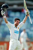 Ed Cowan of the Tigers celebrates after reaching his century during day three of the Sheffield Shield match between Western Australia and Tasmania at...