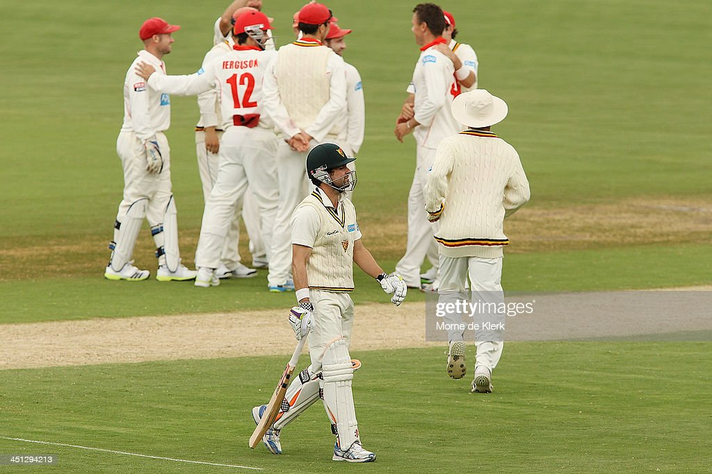 <a gi-track='captionPersonalityLinkClicked' href=/galleries/search?phrase=Ed+Cowan&family=editorial&specificpeople=2207390 ng-click='$event.stopPropagation()'>Ed Cowan</a> of the Tigers leaves the field after getting out during day one of the Sheffield Shield match between the South Australia Redbacks and the Tasmania Tigers at Adelaide Oval on November 22, 2013 in Adelaide, Australia.