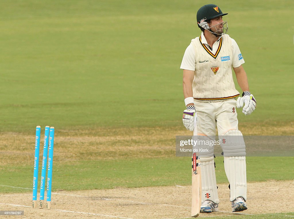 <a gi-track='captionPersonalityLinkClicked' href=/galleries/search?phrase=Ed+Cowan&family=editorial&specificpeople=2207390 ng-click='$event.stopPropagation()'>Ed Cowan</a> of the Tigers looks on after getting bowled out during day one of the Sheffield Shield match between the South Australia Redbacks and the Tasmania Tigers at Adelaide Oval on November 22, 2013 in Adelaide, Australia.