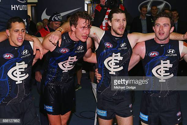 Ed Curnow Daniel Gorringe Bryce Gibbs and Jed Lamb of the Blues sing the club song after winning during the round 10 AFL match between the Carlton...