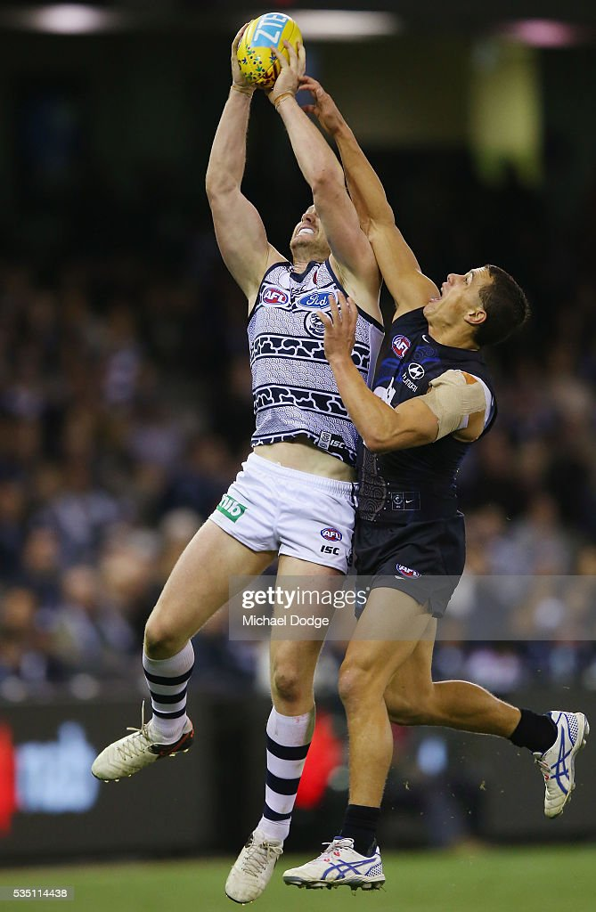 Ed Curnow of the Blues and Dangerfield of the Cats (L) compete for the ball during the round 10 AFL match between the Carlton Blues and the Geelong Cats at Etihad Stadium on May 29, 2016 in Melbourne, Australia.