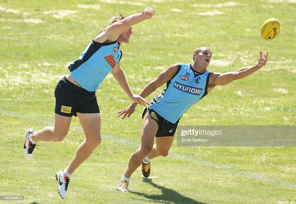 Ed Curnow (R) of the Blues competes for the ball during a Carlton Blues AFL training session at Visy Park on March 7, 2013 in Melbourne, Australia.