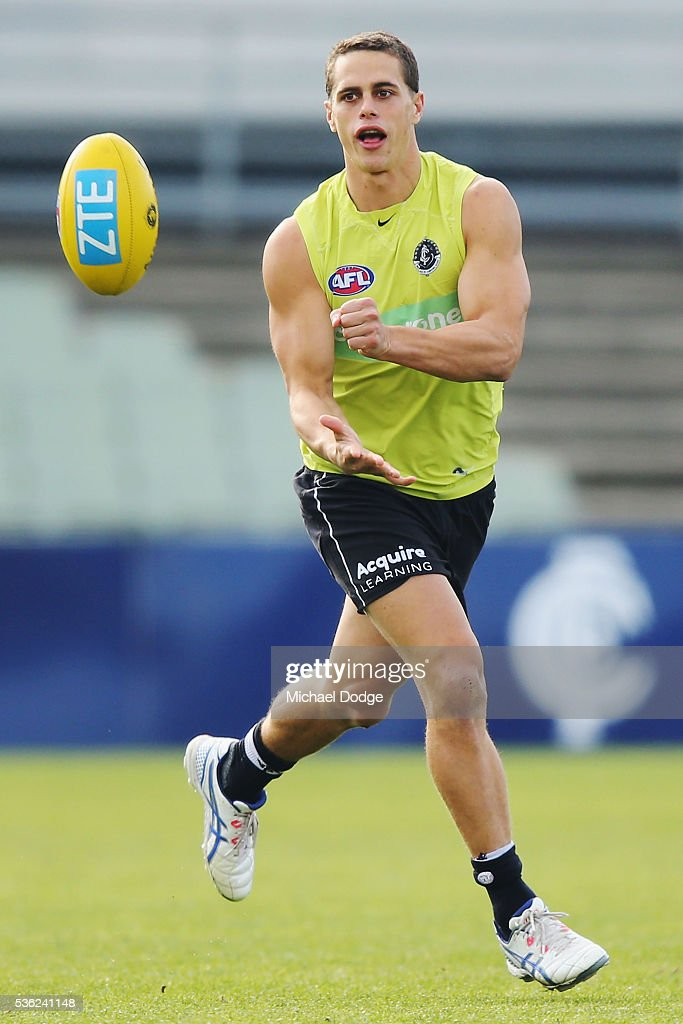 Ed Curnow of the Blues handballs during the Carlton Blues AFL training session at Ikon Park on June 1, 2016 in Melbourne, Australia.