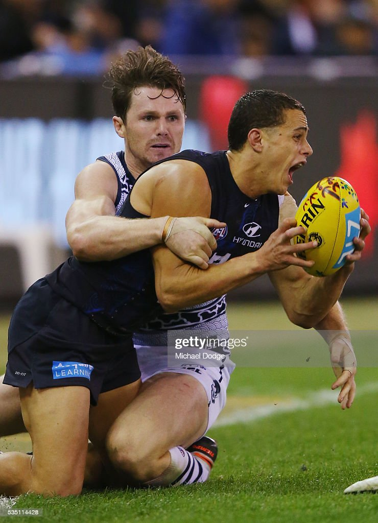 Ed Curnow of the Blues is tackled by <a gi-track='captionPersonalityLinkClicked' href=/galleries/search?phrase=Patrick+Dangerfield&family=editorial&specificpeople=4479400 ng-click='$event.stopPropagation()'>Patrick Dangerfield</a> of the Cats during the round 10 AFL match between the Carlton Blues and the Geelong Cats at Etihad Stadium on May 29, 2016 in Melbourne, Australia.