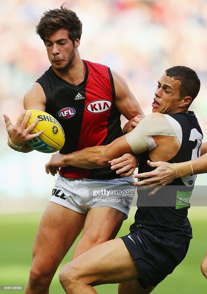 Ed Curnow of the Blues tackles Kyle Langford of the Bombers during the round six AFL match between the Carlton Blues and the Essendon Bombers at Melbourne Cricket Ground on May 1, 2016 in Melbourne, Australia.