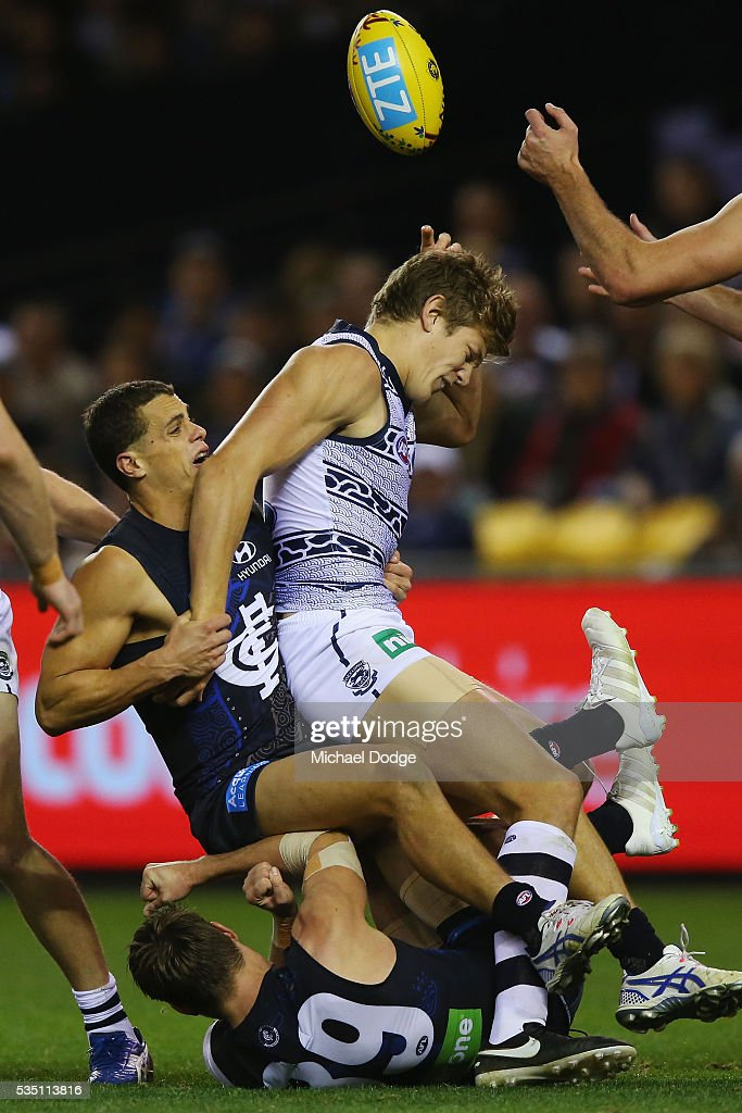 Ed Curnow of the Blues tackles Rhys Stanley of the Cats during the round 10 AFL match between the Carlton Blues and the Geelong Cats at Etihad Stadium on May 29, 2016 in Melbourne, Australia.