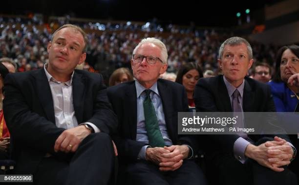 Ed Davey MP Norman Lamb MP and leader of the Scottish Liberal Democrats Willie Rennie listen to leader Sir Vince Cable's keynote speech at the...