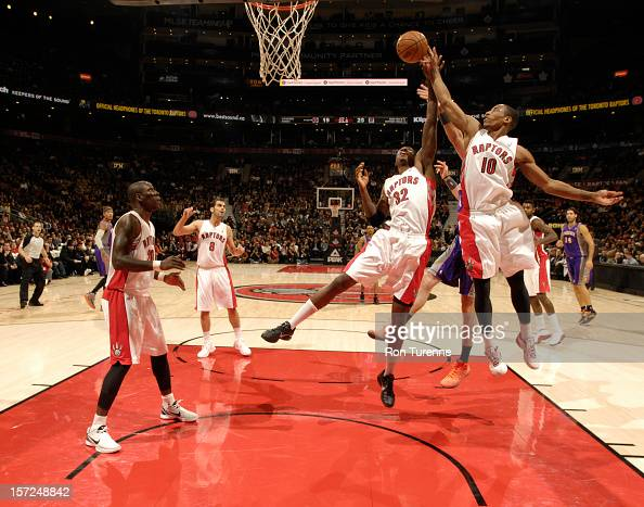 Ed Davis and DeMar DeRozan of the Toronto Raptors rebound against the Phoenix Suns on November 30 2012 at the Air Canada Centre in Toronto Ontario...