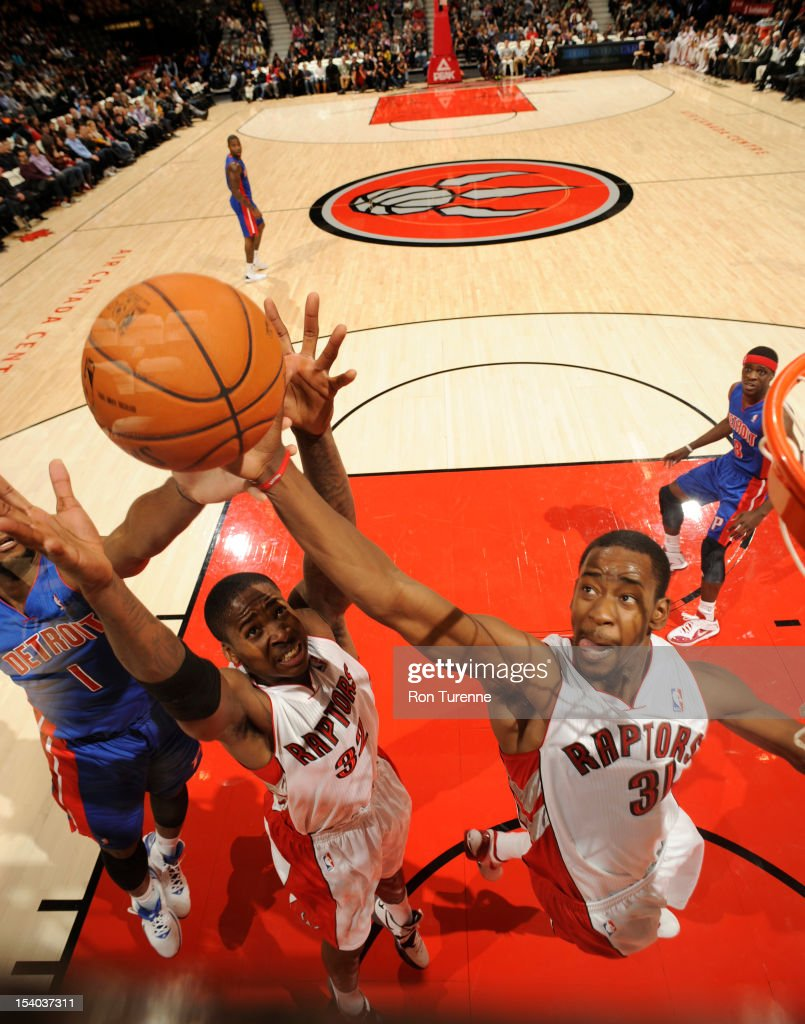 Ed Davis #32 and <a gi-track='captionPersonalityLinkClicked' href=/galleries/search?phrase=Terrence+Ross&family=editorial&specificpeople=6781663 ng-click='$event.stopPropagation()'>Terrence Ross</a> #31 of the Toronto Raptors grabs the rebound against the Detroit Pistons October 12, 2012 at the Air Canada Centre in Toronto, Ontario, Canada.