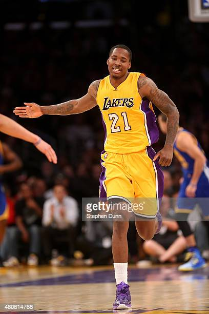 Ed Davis of the Los Angeles Lakers celebrates after dunking against the Golden State Warriors at Staples Center on December 23 2014 in Los Angeles...
