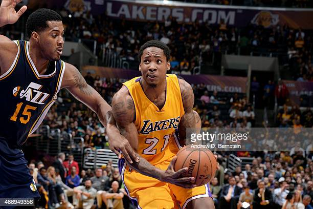 Ed Davis of the Los Angeles Lakers drives against Derrick Favors of the Utah Jazz on March 19 2015 at STAPLES Center in Los Angeles California NOTE...