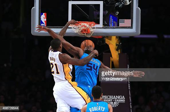 Ed Davis of the Los Angeles Lakers slam dunks against Jason Maxiell of the Charlotte Hornets in the first half during the NBA game at Staples Center...