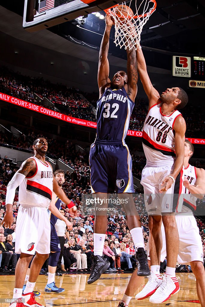 Ed Davis #32 of the Memphis Grizzlies rises for a dunk against Nicolas Batum #88 of the Portland Trail Blazers on March 12, 2013 at the Rose Garden Arena in Portland, Oregon.