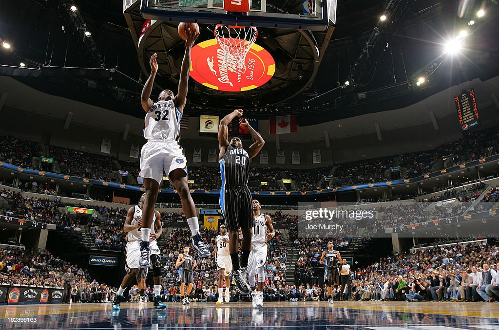 Ed Davis #32 of the Memphis Grizzlies shoots a layup against <a gi-track='captionPersonalityLinkClicked' href=/galleries/search?phrase=DeQuan+Jones&family=editorial&specificpeople=5626127 ng-click='$event.stopPropagation()'>DeQuan Jones</a> #20 of the Orlando Magic on February 22, 2013 at FedExForum in Memphis, Tennessee.