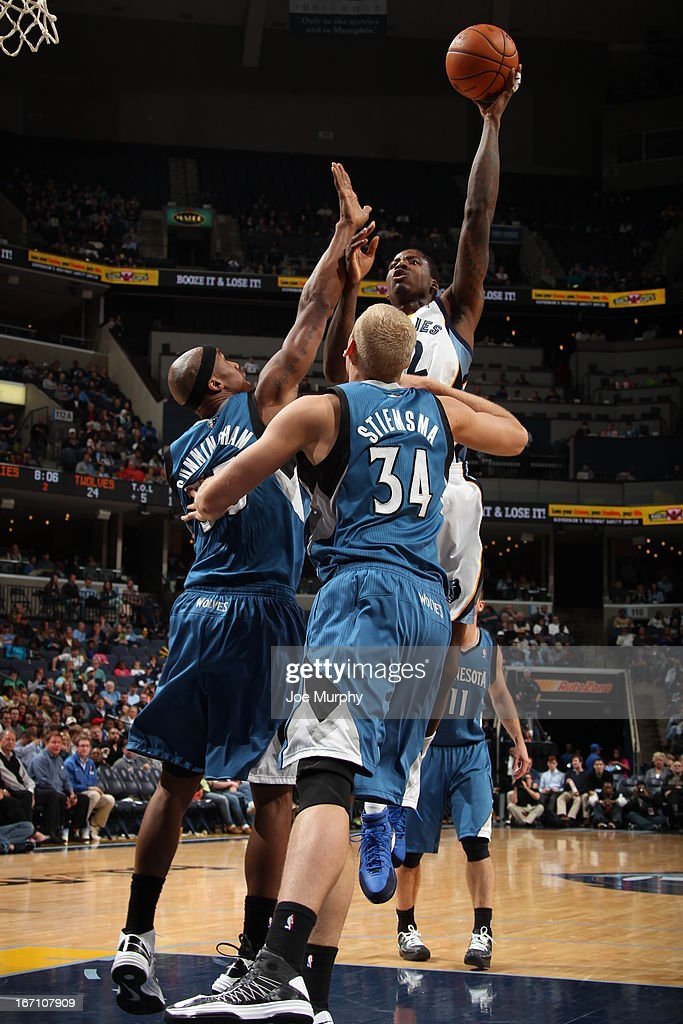 Ed Davis #32 of the Memphis Grizzlies shoots against <a gi-track='captionPersonalityLinkClicked' href=/galleries/search?phrase=Dante+Cunningham&family=editorial&specificpeople=683729 ng-click='$event.stopPropagation()'>Dante Cunningham</a> #33 and <a gi-track='captionPersonalityLinkClicked' href=/galleries/search?phrase=Greg+Stiemsma&family=editorial&specificpeople=2098297 ng-click='$event.stopPropagation()'>Greg Stiemsma</a> #34 of the Minnesota Timberwolves on March 18, 2013 at FedExForum in Memphis, Tennessee.