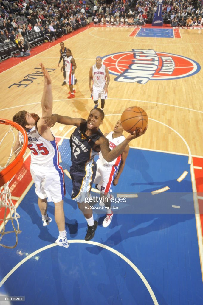 Ed Davis of the Memphis Grizzlies shoots against Viacheslav Kravtsov of the Detroit Pistons on February 19 2013 at The Palace of Auburn Hills in...