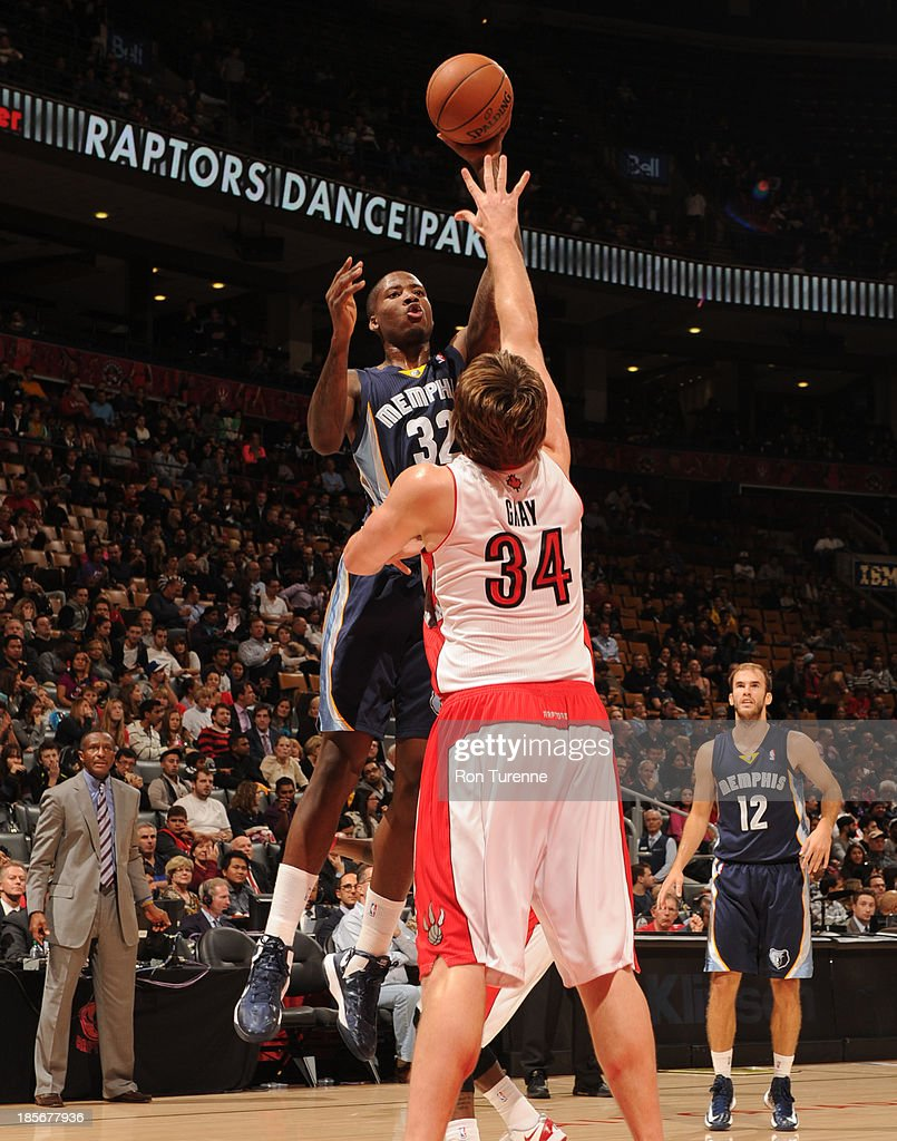 Ed Davis #32 of the Memphis Grizzlies shoots the ball against <a gi-track='captionPersonalityLinkClicked' href=/galleries/search?phrase=Aaron+Gray+-+Basketball+Player&family=editorial&specificpeople=666453 ng-click='$event.stopPropagation()'>Aaron Gray</a> #34 of the Toronto Raptors during the game on October 23, 2013 at the Air Canada Centre in Toronto, Ontario, Canada.