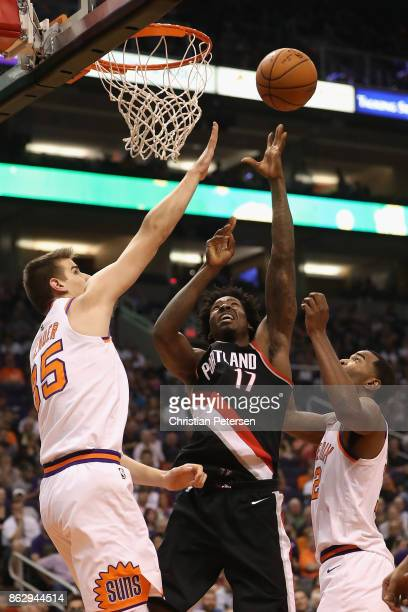 Ed Davis of the Portland Trail Blazers attempts a shot over Dragan Bender of the Phoenix Suns during the second half of the NBA game at Talking Stick...