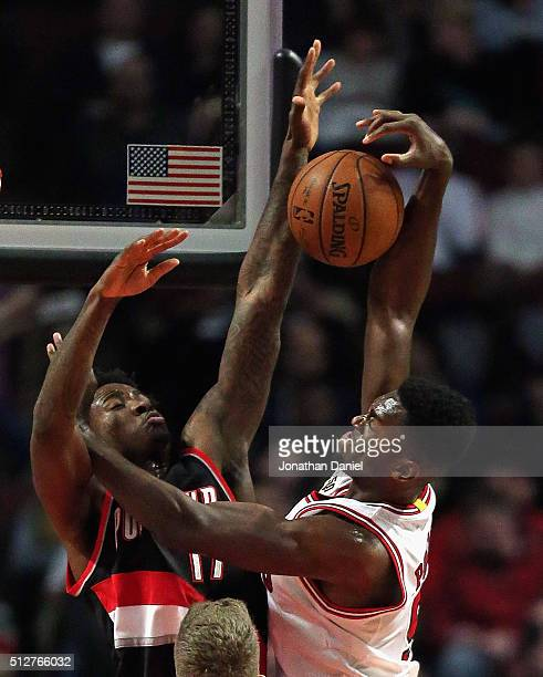 Ed Davis of the Portland Trail Blazers blocks a shot by Bobby Portis of the Chicago Bulls at the United Center on February 27 2016 in Chicago...