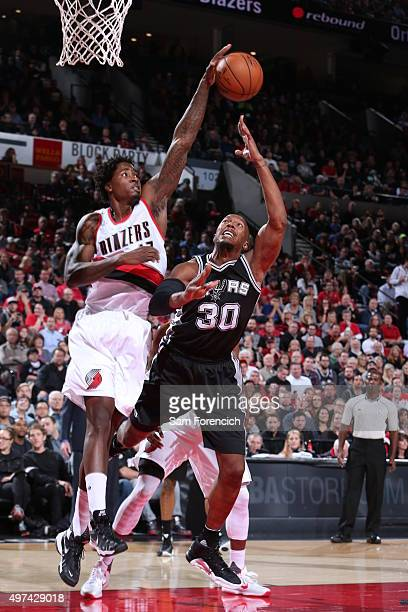 Ed Davis of the Portland Trail Blazers blocks the shot of David West of the San Antonio Spurs on November 11 2015 at the Moda Center Arena in...
