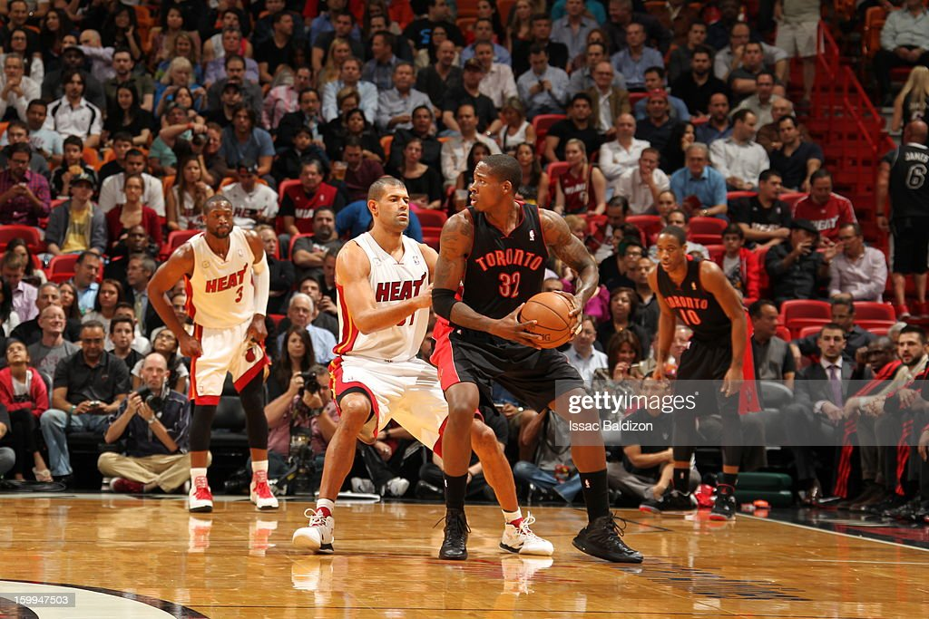 Ed Davis #32 of the Toronto Raptors controls the ball against Shane Battier #31 of the Miami Heat on January 23, 2013 at American Airlines Arena in Miami, Florida.