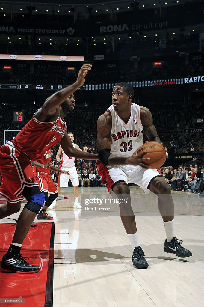 Ed Davis #32 of the Toronto Raptors drives against <a gi-track='captionPersonalityLinkClicked' href=/galleries/search?phrase=Luc+Richard+Mbah+a+Moute&family=editorial&specificpeople=699041 ng-click='$event.stopPropagation()'>Luc Richard Mbah a Moute</a> #12 of the Milwaukee Bucks during the game on January 13, 2013 at the Air Canada Centre in Toronto, Ontario, Canada.