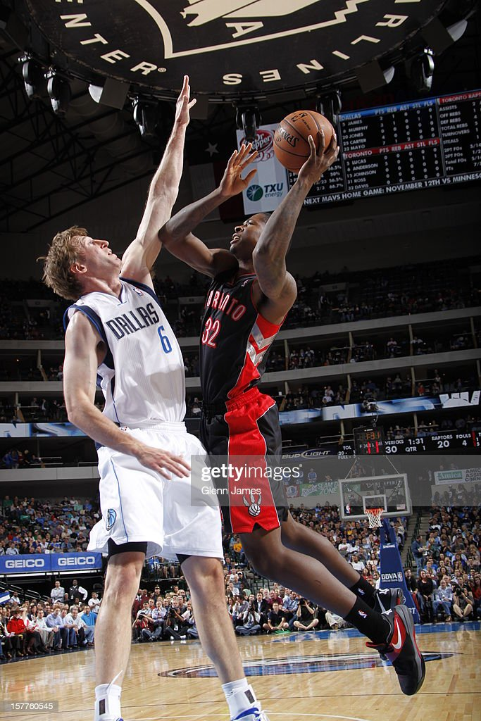 Ed Davis #32 of the Toronto Raptors drives to the basket against <a gi-track='captionPersonalityLinkClicked' href=/galleries/search?phrase=Troy+Murphy+-+Basketball+Player&family=editorial&specificpeople=201794 ng-click='$event.stopPropagation()'>Troy Murphy</a> #6 of the Dallas Mavericks on November 7, 2012 at the American Airlines Center in Dallas, Texas.