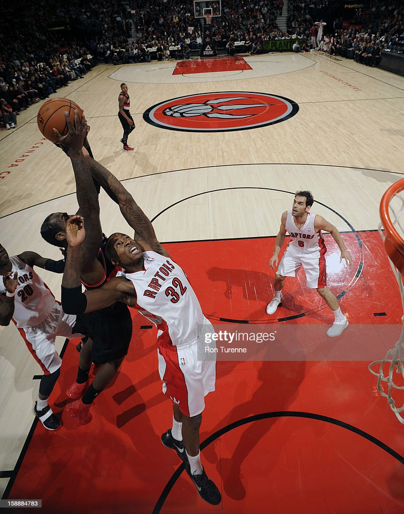 Ed Davis #32 of the Toronto Raptors fights for the ball against the Portland Trail Blazers during the game on January 2, 2013 at the Air Canada Centre in Toronto, Ontario, Canada.