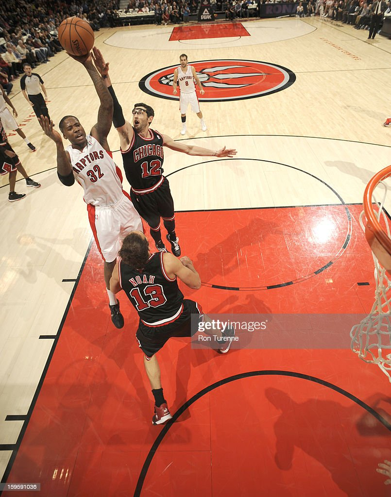 Ed Davis #32 of the Toronto Raptors goes to the basket against <a gi-track='captionPersonalityLinkClicked' href=/galleries/search?phrase=Kirk+Hinrich&family=editorial&specificpeople=201629 ng-click='$event.stopPropagation()'>Kirk Hinrich</a> #12 of the Chicago Bulls during the game between the Toronto Raptors and the Chicago Bulls on January 16, 2013 at the Air Canada Centre in Toronto, Ontario, Canada.
