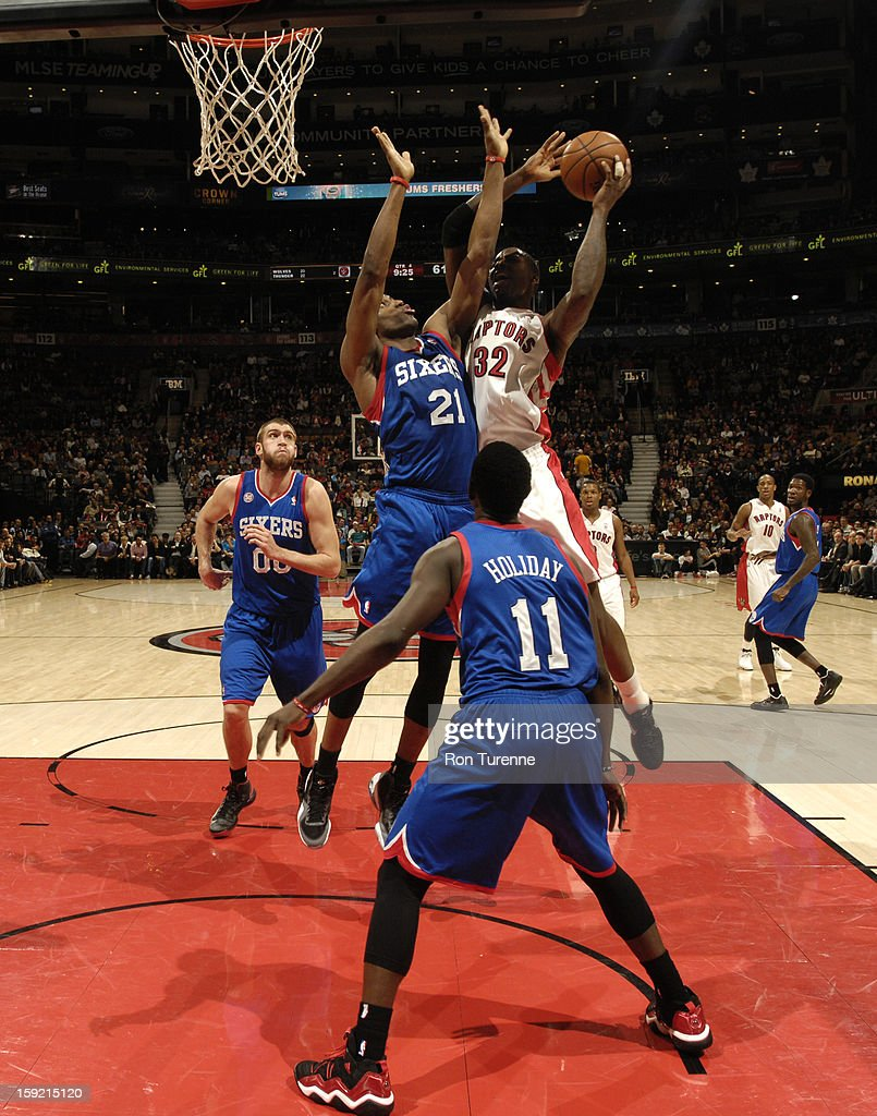 Ed Davis #32 of the Toronto Raptors goes up for the layup against <a gi-track='captionPersonalityLinkClicked' href=/galleries/search?phrase=Thaddeus+Young&family=editorial&specificpeople=3847270 ng-click='$event.stopPropagation()'>Thaddeus Young</a> #21 of Philadelphia 76ers during the game on January 9, 2013 at the Air Canada Centre in Toronto, Ontario, Canada.