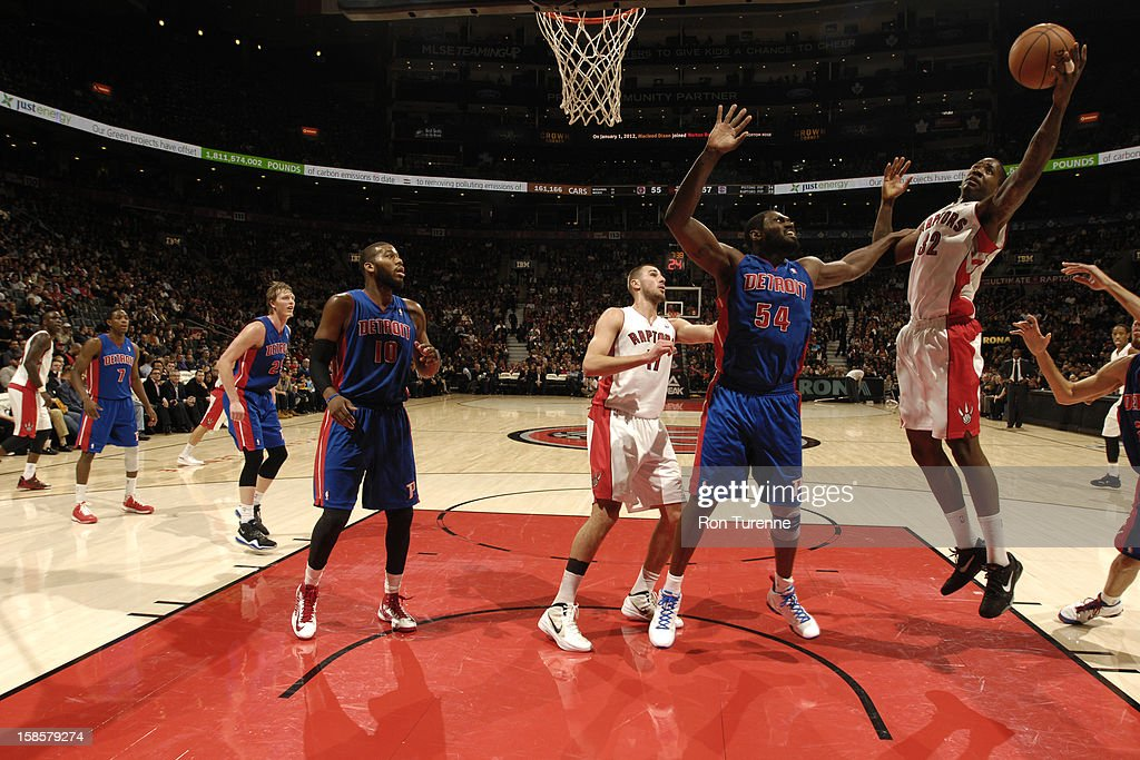 Ed Davis #32 of the Toronto Raptors goes up for the layup while <a gi-track='captionPersonalityLinkClicked' href=/galleries/search?phrase=Jason+Maxiell&family=editorial&specificpeople=651723 ng-click='$event.stopPropagation()'>Jason Maxiell</a> #54 of Detroit Pistons defends him during the game on December 19, 2012 at the Air Canada Centre in Toronto, Ontario, Canada.